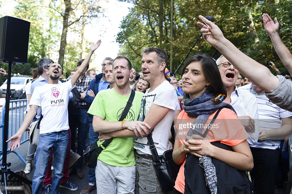 People take part in a 'Kiss in' rally in Brussels, on September 8, 2013, to protest against an 'anti-gay' Russian law.
