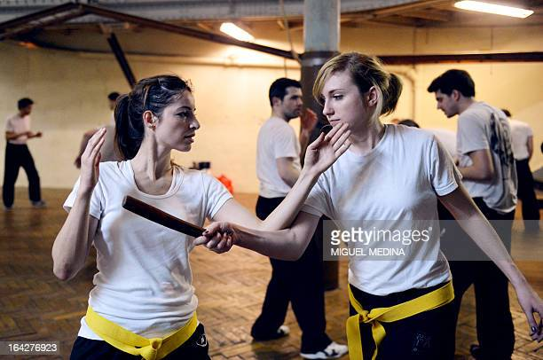 People take part in a Krav Maga training session on March 14 2013 in Paris AFP PHOTO MIGUEL MEDINA