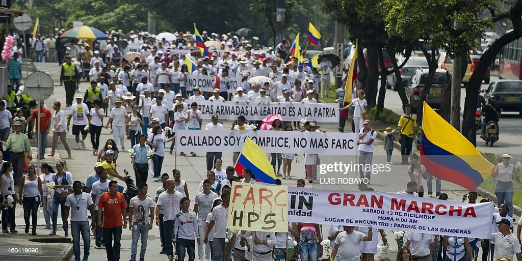 People take part in a march against the current peace talks with FARC rebels in Cali Department of Valle del Cauca Colombia on December 13 2014...