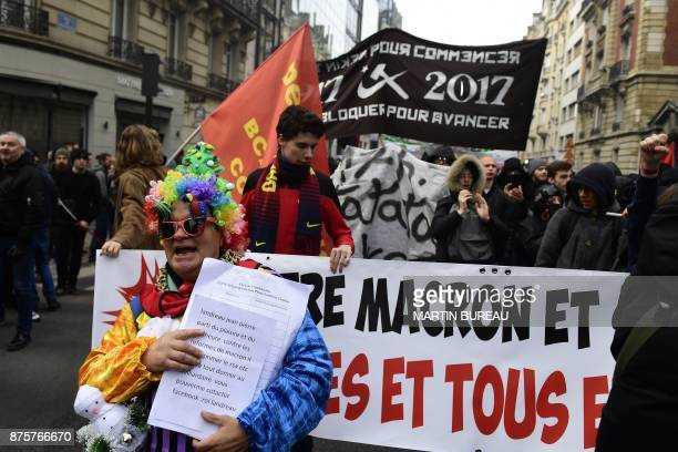 People take part in a march dubbed 'marche sur l'Elysée' called by the Social Front against the Government's measures on assisted jobs labour law...