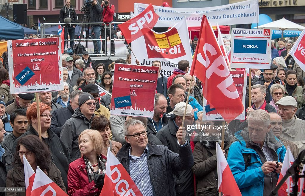 People take part in a May Day or International Workers' Day rally in Stuttgart, southern Germany, on May 1, 2016. / AFP / dpa / Daniel Maurer / Germany OUT