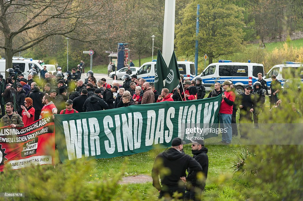 People take part in a May Day rally in Plauen, Germany, 01 May 2014. Protests and demonstrations are being held all across Germany to mark International Workers' Day.