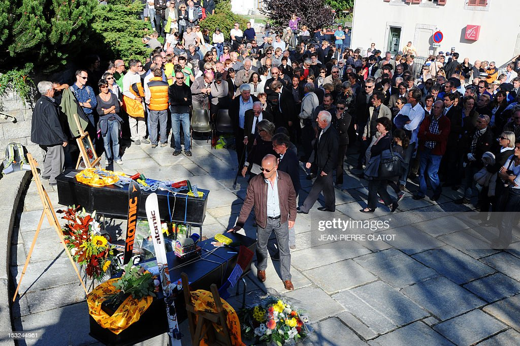 People take part in a memorial ceremony to pay tribute to the victims of the last week avalanche on Nepal's Manaslu mountain, on October 2, 2012, in Chamonix, that is considered the birthplace of European alpinism and the home of most of the French climbers killed. The four French -- two guides and two clients -- were among eight people killed after an avalanche swept through their camp on the side of the 8,156-metre (26,759-foot) Himalayan mountain, just hours before the alpinists were to make an attempt to reach the peak's summit.