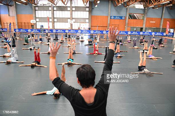 People take part in a modern dance lesson as part of the 10th edition of the Darc dance festival on August 13 in Chateauroux central France The Darc...