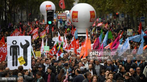 People take part in a nationwide strikes and demonstrations day called by nine unions representing 54 million public sector workers on October 10...