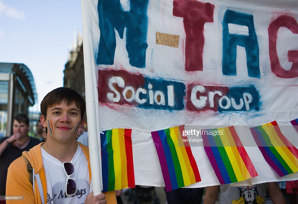 People take part in a parade during a Community Pride event on September 14, 2013 in Middlesbrough, England. The parade was the culmination of a three day event to raise awareness and celebrate Lesbian, Gay, Bi-sexual and Transgender life.