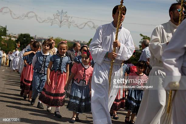 People take part in a procession at Pradera de San Isidro park during the San Isidro festivities on May 15 2014 in Madrid Spain During the...