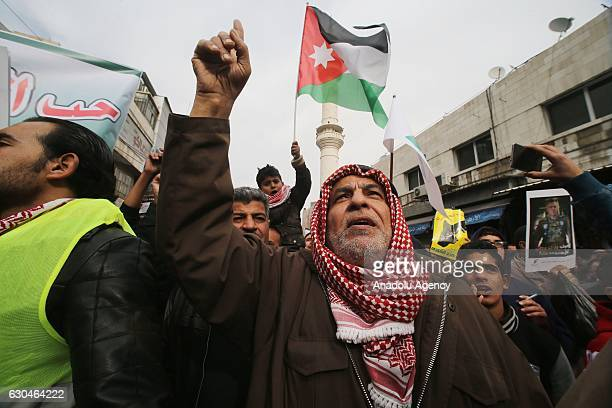 People take part in a protest after the gunmen attacked several police patrols in the southern city of Karak in Amman Jordan on December 23 2016...