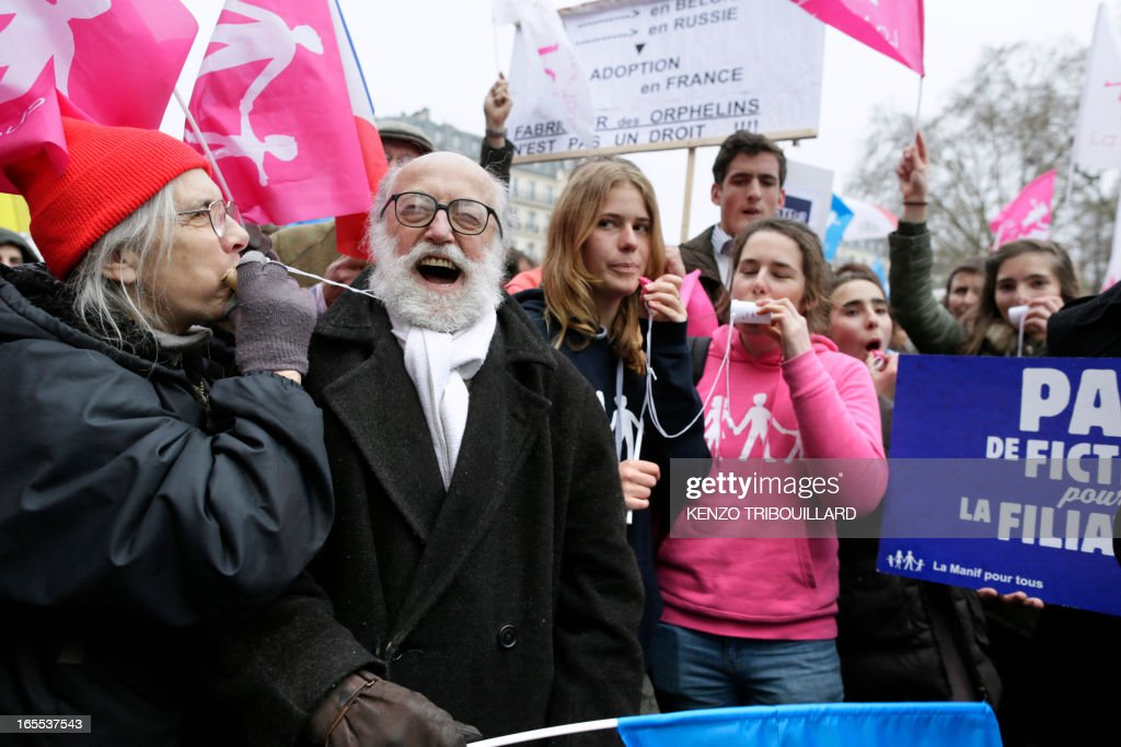 People take part in a protest against gay marriage on April 4, 2013 in front of the French Senate in Paris, on the first day of the debate at France's upper house on the controversial bill to legalise same-sex marriage and adoption. While the upper house is unlikely to reject the groundbreaking reform, it is still expected to be a tight vote as the ruling Socialists enjoy a smaller majority in the Senate than in the National Assembly. AFP PHOTO / KENZO TRIBOUILLARD