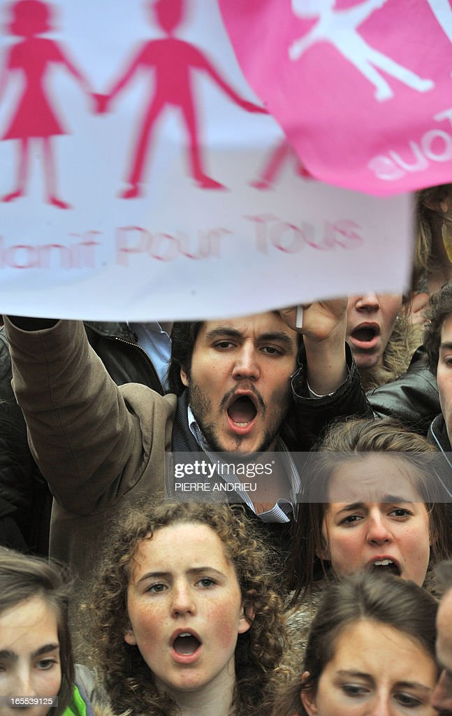 People take part in a protest against gay marriage on April 4, 2013 in front of the French Senate in Paris, on the first day of the debate at France's upper house on the controversial bill to legalise same-sex marriage and adoption. While the upper house is unlikely to reject the groundbreaking reform, it is still expected to be a tight vote as the ruling Socialists enjoy a smaller majority in the Senate than in the National Assembly.