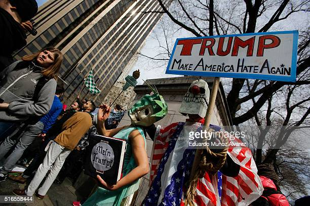 People take part in a protest against Republican presidential candidate Donald Trump on March 19 2016 in New York City People protest against Trump's...