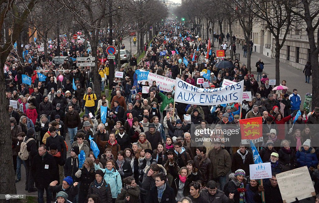 People take part in a protest against same-sex marriage on January 13, 2013 in Paris. Tens of thousands march in Paris on January 13 to denounce government plans to legalise same-sex marriage and adoption which have angered many Catholics and Muslims, France's two main faiths, as well as the right-wing opposition. The French parliament is to debate the bill -- one of the key electoral pledges of Socialist President -- at the end of this month.