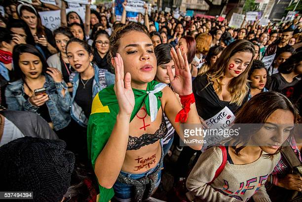 People take part in a protest against the gangrape of a 16yearold girl last week in a favela in Rio de Janeiro in Paulista Avenue in Sao Paulo Brazil...