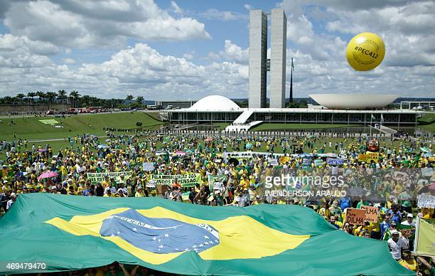 People take part in a protest against the government of Brazilian President Dilma Rousseff in Brasilia on April 12 22015 A new round of protests...