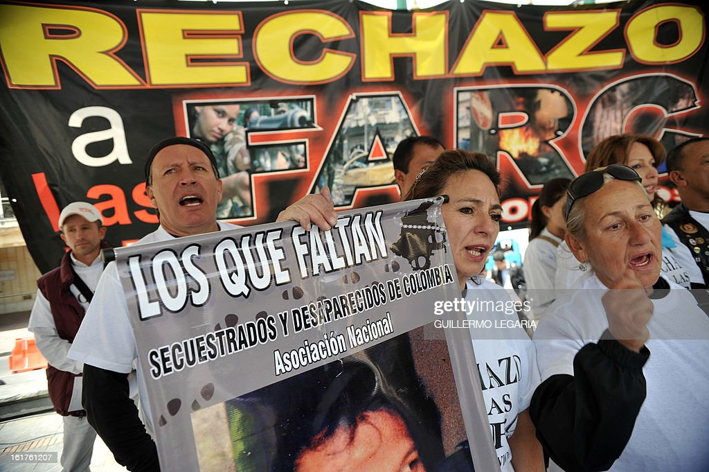 People take part in a protest against the Revolutionary Armed Forces of Colombia (FARC) guerrillas and to ask for the release of hostages on February 15, 2013 in Bogota, Colombia. The protest aims to reject the latest terrorist attacks and abductions of civil and military people while the guerrillas hold peace negotiations with the government in Havana, Cuba. AFP PHOTO/Guillermo LEGARIA