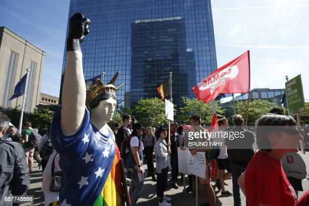 People take part in a protest march against the US president and the Belgian Prime Minister in the city center of Brussels on May 24 2017 US...