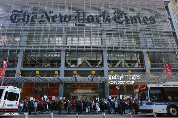 People take part in a protest outside the New York Times on February 26 2017 in New York The White House denied access Frebuary 24 2017 to an...