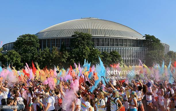People take part in a rainbow run in Brno Czech Republic on August 29 2015 People taking part in the 5km charity run are throw colours during the run...