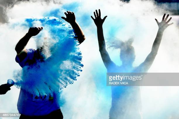People take part in a rainbow run in Brno Czech Republic on August 29 2015 People taking part in the 5km charity run throw colours during the run AFP...