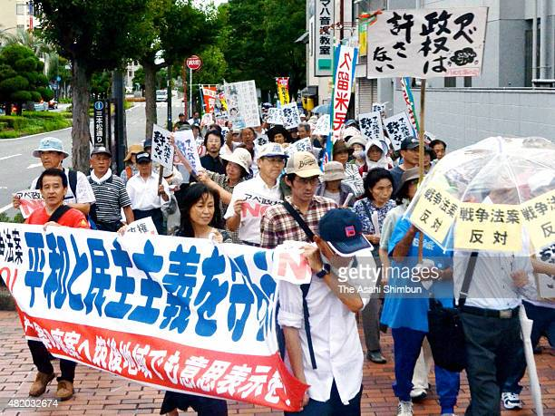 People take part in a rally against antisecurity legislation bills on July 26 2015 in Kurume Fukuoka Japan