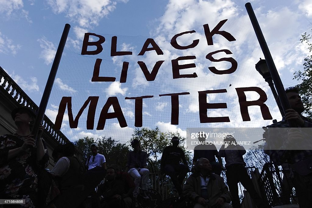 People take part in a rally on April 29 2015 at Union Square in New York held in solidarity with demonstrators in Baltimore Maryland demanding...