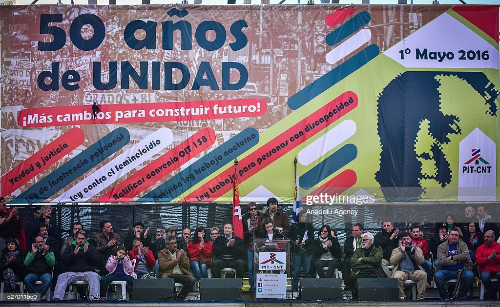 People take part in a rally to mark May Day, International Workers' Day in in Montevideo on May 1, 2016.