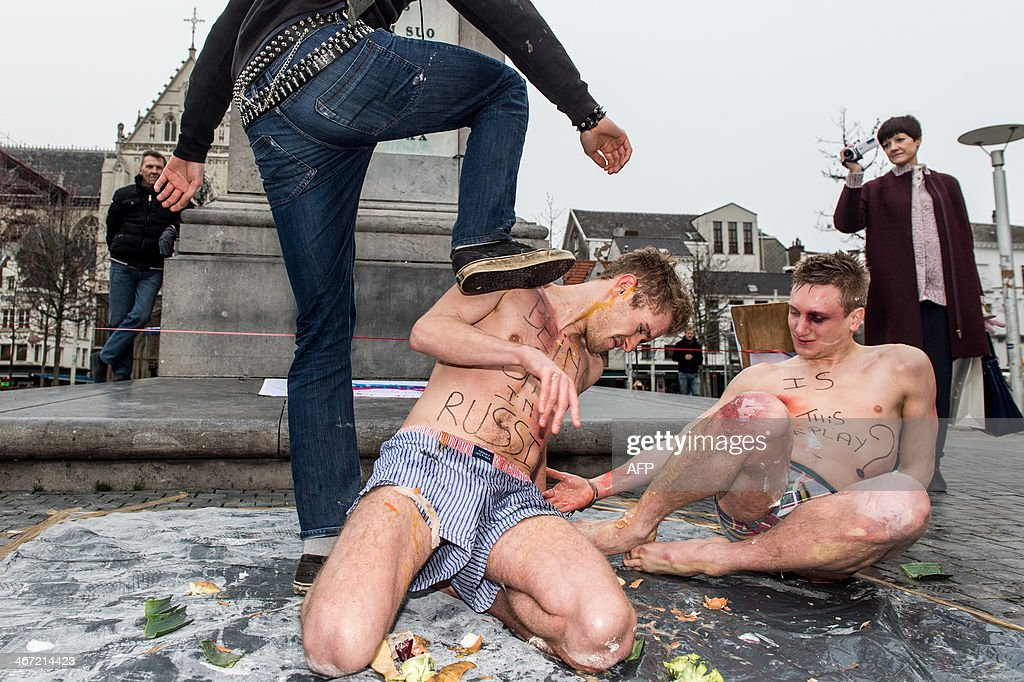People take part in a role play organized by gay youth movement 'Wel Jong Niet Hetero' to show the violence suffered by lesbian gay bisexual and...