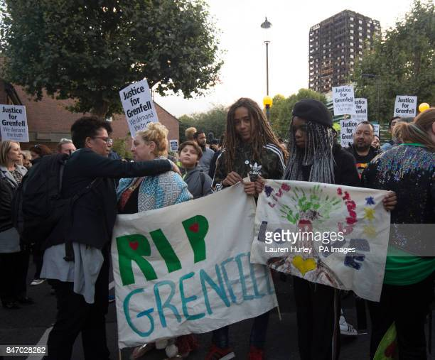 People take part in a silent march for Grenfell Tower fire victims in west London