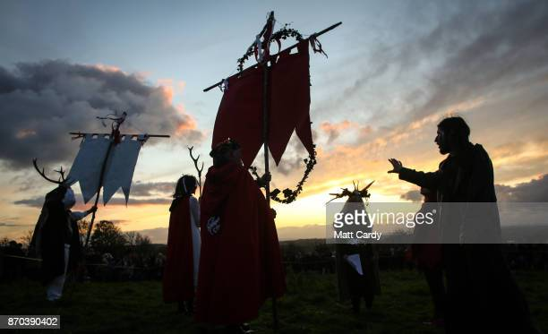 People take part in a sunset ceremony as they celebrate Samhain at the Glastonbury Dragons Samhain Wild Hunt 2017 in Glastonbury on November 4 2017...