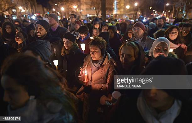 People take part in a vigil for three young Muslims killed in Chapel Hill North Carolina at Dupont Circle on February 12 2015 in Washington DC The...