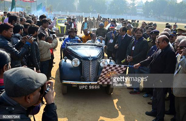 People take part in a vintage car rally organized by Rotary Club in Allahabad