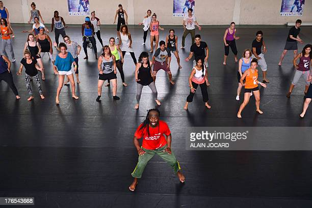 People take part in an African dance lesson as part of the 10th edition of the Darc dance festival on August 13 in Chateauroux central France The...