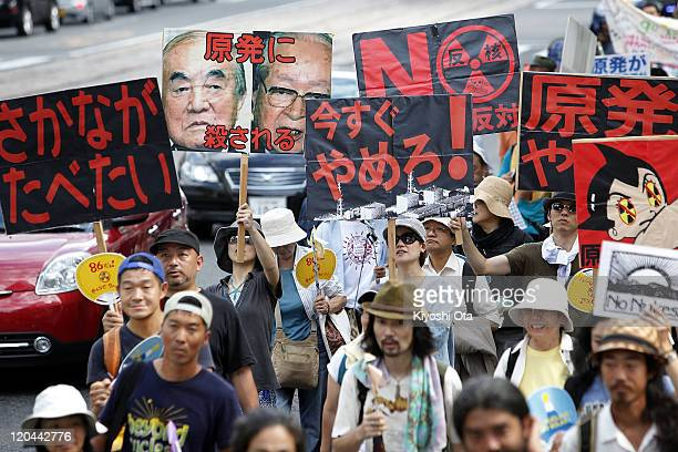 People take part in an antinuclear power march on the 66th anniversary of the Hiroshima atomic bombing on August 6 2011 in Hiroshima Japan The...