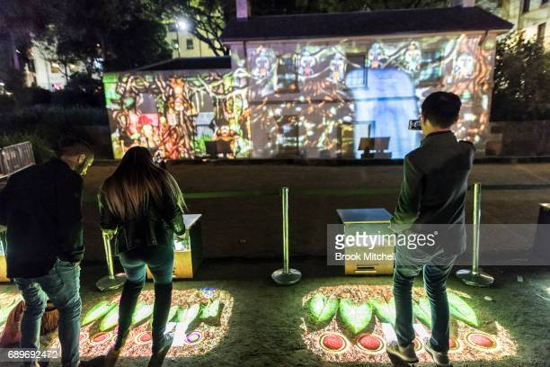 People take part in an interactive light installation during the Vivid Festival on May 29 2017 in Sydney Australia Vivid Sydney is an annual festival...