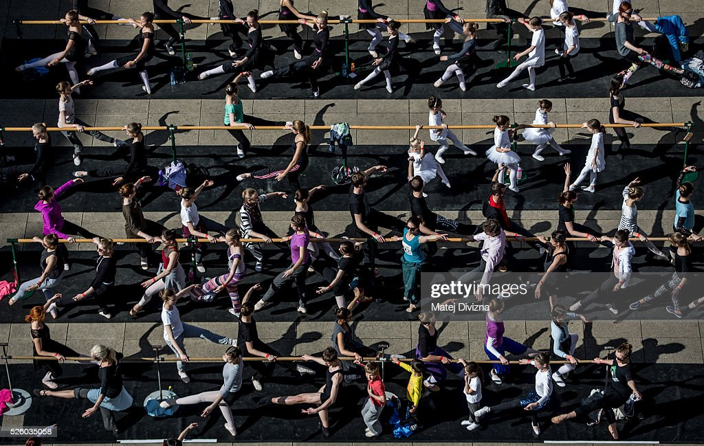 People take part in an outdoor ballet class at the International Dance Day in front of the National Theatre on April 29, 2016 in Prague, Czech Republic. International Dance Day, which was introduced in 1982, is celebrated around the world on April 29.