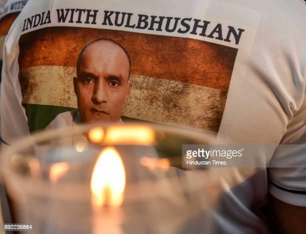 People take part in candle light peace prayer march demanding suspension of Kulbhushan Yadav's death sentence at Cuury Road on June 3 2017 in Mumbai...