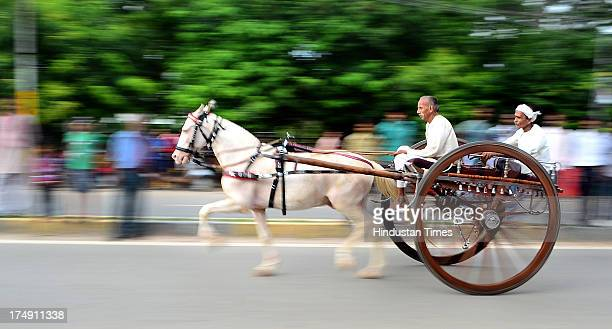 People take part in Horsecart racing locally known as Gahre Bazi on the streets of Sangam City on July 29 2013 in Allahabad India The traditional...