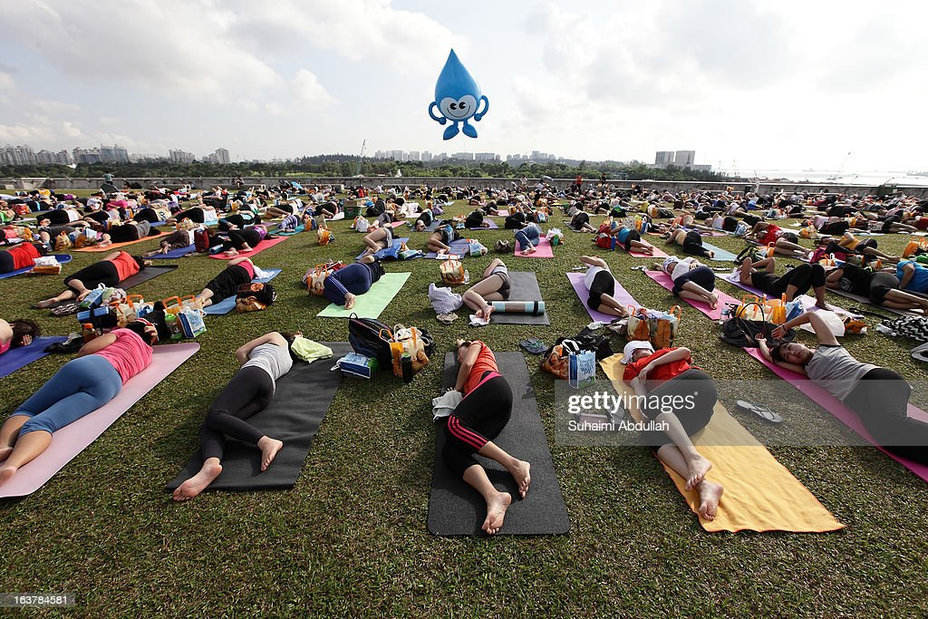 People take part in mass yoga session on the green roof of Marina Barrage in celebration of the Singapore World Water Day on March 16, 2013 in Singapore. World Water Day is a global celebration of the importance of freshwater, and the crucial need for sensibile and sustainable management of water.