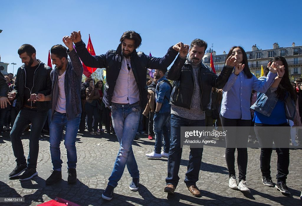 People take part in May Day rally at Place de la Bastille in Paris, France on May 01, 2016.