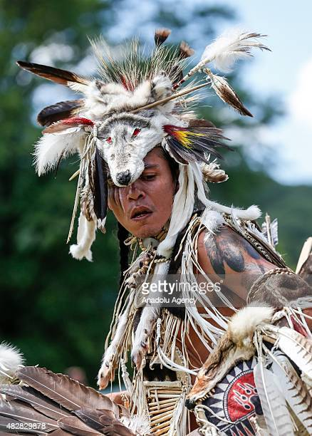 People take part in the 25th Annual Pow Wow Festival at the Bear Mountain State Park in New York United States on August 3 2015