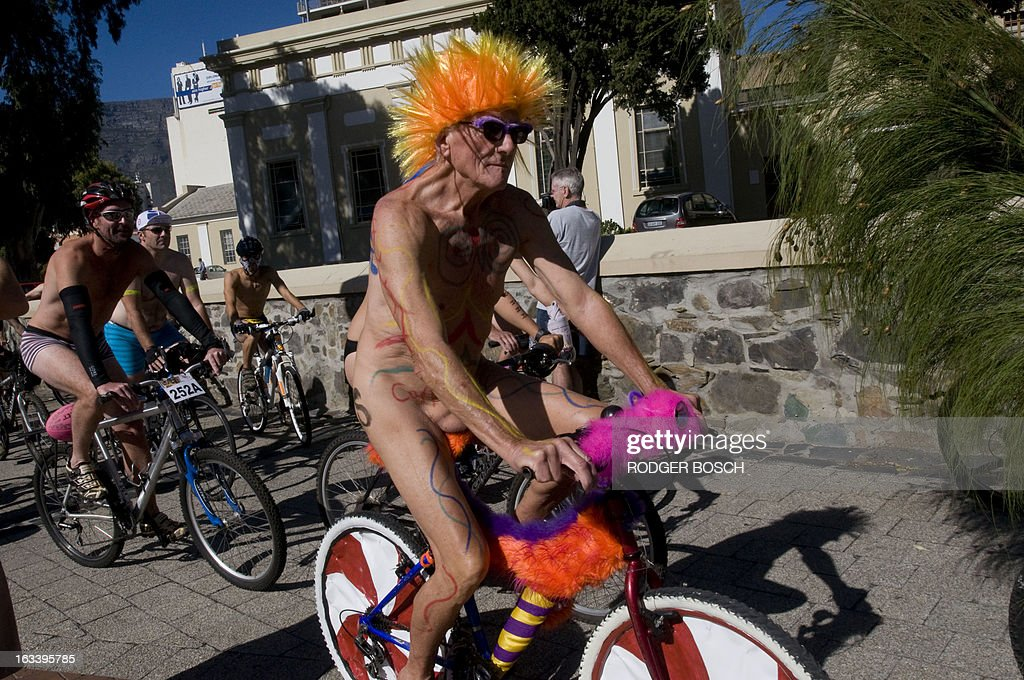People take part in the 3rd annual Cape Town Naked Bike Ride on March 9, 2013 in Cape Town. This event is a protest against car culture and to raise awareness of cycling as an environmentally friendly option. The World Naked Bike Ride(WNBR) is an initative that takes place in over 50 cities around the world. AFP PHOTO / RODGER BOSCH