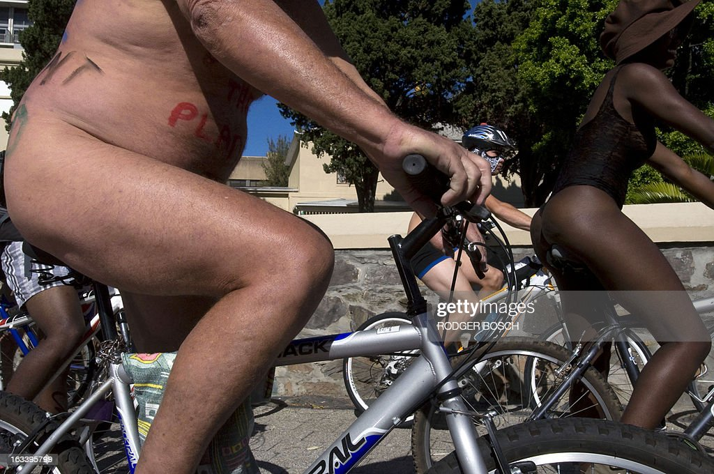 People take part in the 3rd annual Cape Town Naked Bike Ride on March 9, 2013 in Cape Town. This event is a protest against car culture and to raise awareness of cycling as an environmentally friendly option. The World Naked Bike Ride(WNBR) is an initative that takes place in over 50 cities around the world.