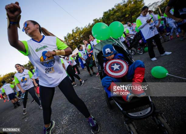 People take part in the '5K Heroes with True Battles' in support of children with cancer in Managua on February 19 2017 People of all ages wearing...