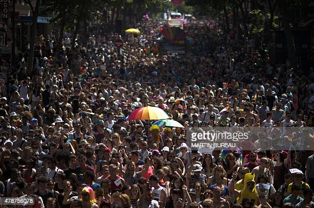 People take part in the annual Gay Pride homosexual bisexual and transgender visibility march on June 27 2015 in Paris AFP PHOTO / MARTIN BUREAU