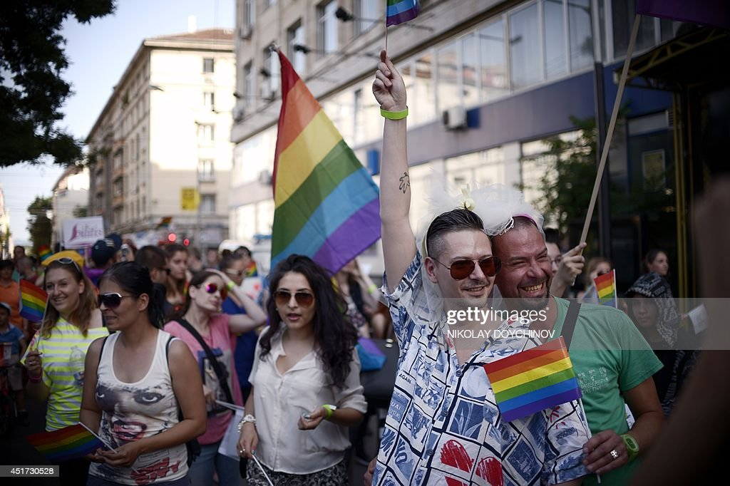 People take part in the annual Gay Pride parade in central Sofia on July 5, 2014, as people march through the Bulgarian capital to protest discrimination against gays, lesbians and transsexuals and improve their integration in society.