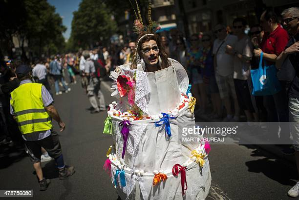 People take part in the annual Gay Pride the homosexual bisexual and transgender visibility march on June 27 2015 in Paris AFP PHOTO / MARTIN BUREAU