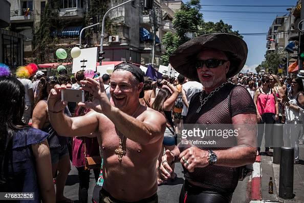 People take part in the annual Tel Aviv Gay Pride parade on June 12 2015 in Tel Aviv Israel Thousands of people gathered in Tel Aviv for the parade...