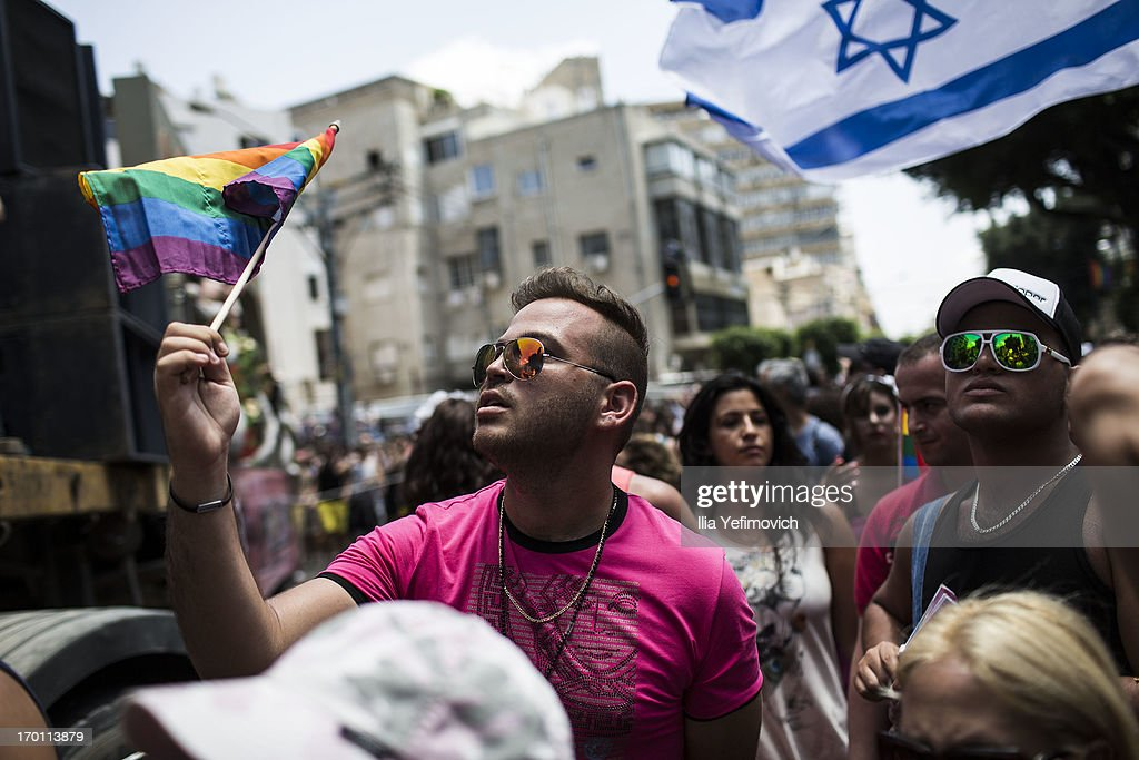 People take part in the annual Tel Aviv Gay Pride parade on June 7, 2013 in Tel Aviv, Israel. Thousands of people gathered in Tel Aviv for the parade, which attracts visitors from all over the world.