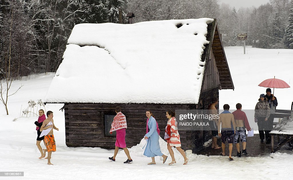 People take part in the European Sauna Marathon in Otepaeae, southern Estonia, on February 10, 2013. Around 600 participants in 150 teams compete in the event to find out which team takes the shortest time to use 22 saunas and to jump into nine ice holes.
