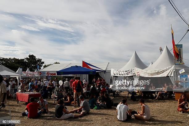 People take part in the Fete de l'Humanite in La Courneuve near Paris on September 10 2016 / AFP / Thomas SAMSON